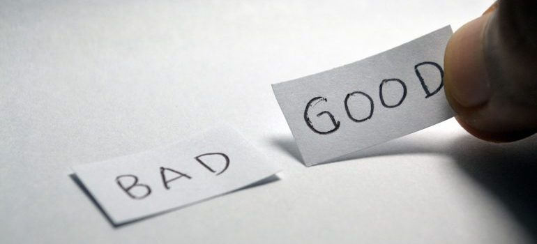 Two pieces of paper with the words bad and good on them.