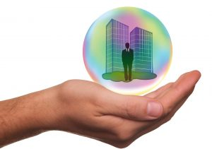 Hand holding a bubble with a business illustration