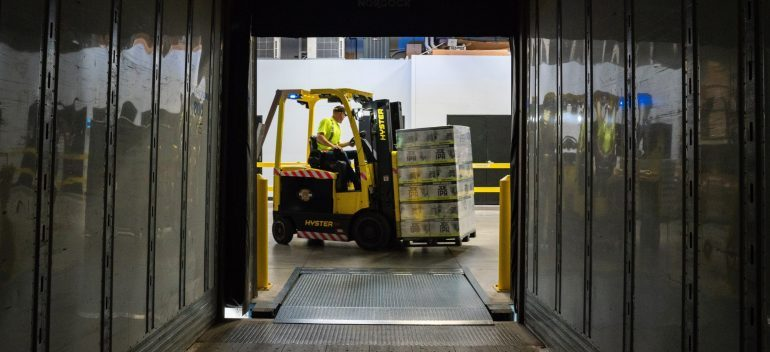 a forklift carrying packages