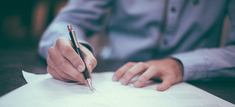 man signing contract for packing medical supplies for transport