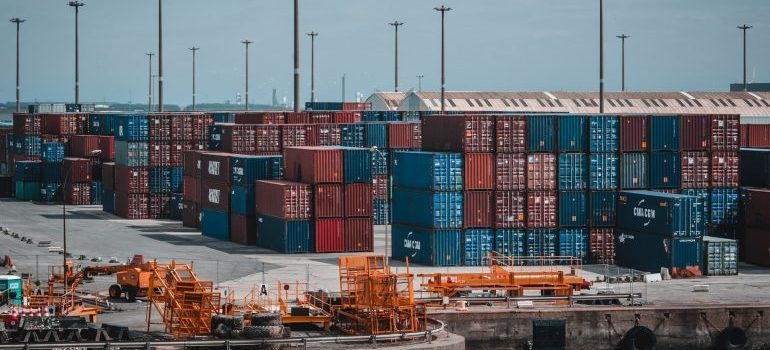 Professionals handling climate-controlled cargo containers