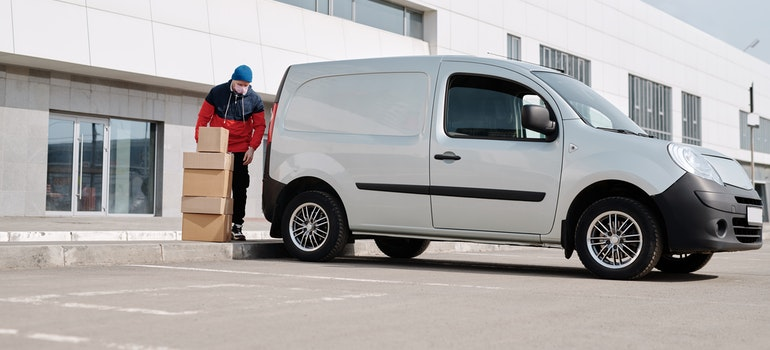 Man packing boxes in a van