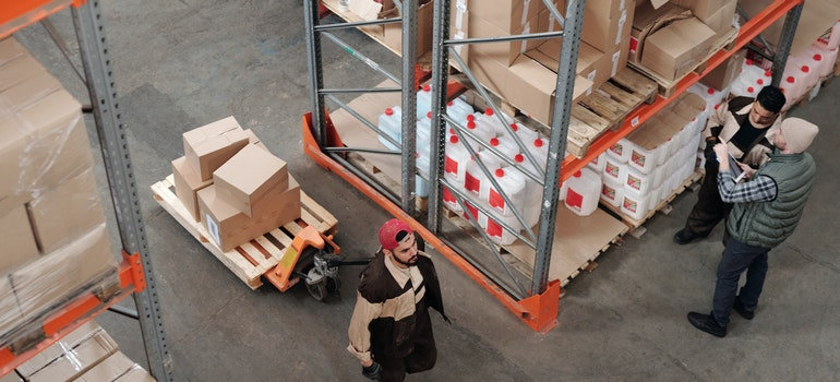 Man in a warehouse working to reduce last -delivery costs