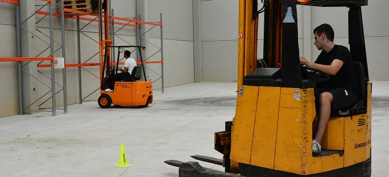 Two forklifts in a warehouse