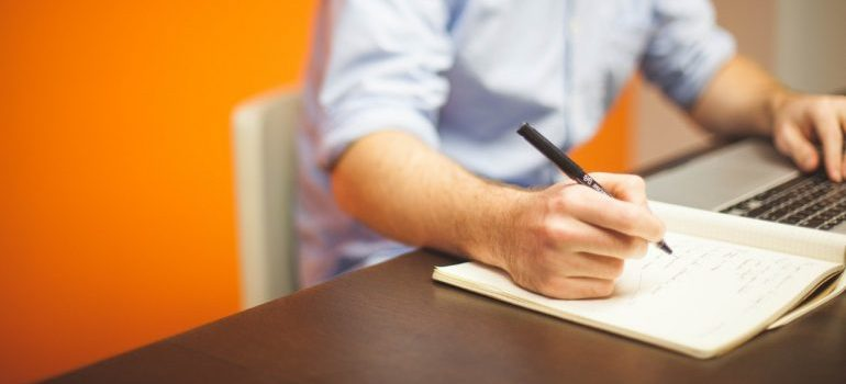 man writing in office