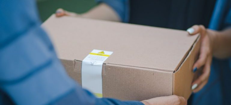 woman handing over the package to the man